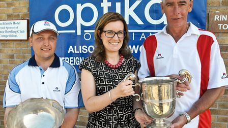 Tournament sponsor Alison Harwood from Optika presenting the Singles Champion trophy to Mike Rickets