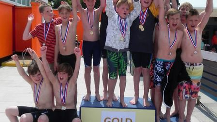 Boys relay medal winners at the inter-schools swimming gala.