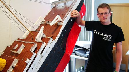 Lorin Robinson with his model of the Titanic.
