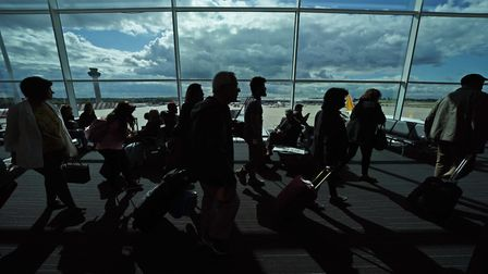 Passengers waiting in a departure lounge at London Stansted Airport. Photograph: Yui Mok/PA.