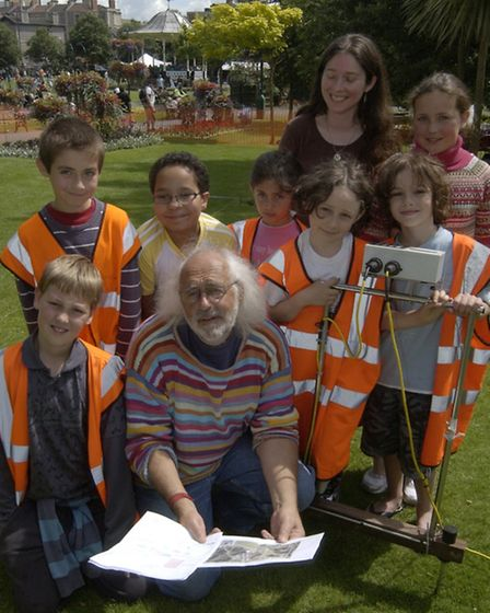 Time Team's Mick Aston, pictured with young students during at archaeology in the park event in West
