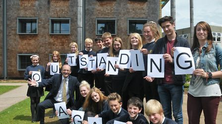 Head Teacher Julian Baldwin and pupils celebrating Backwell School's second oustanding Ofsted.