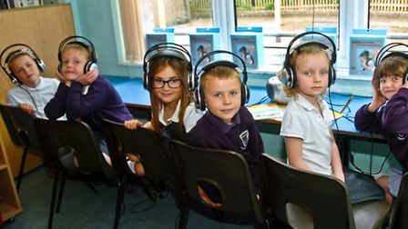 Children using new listening stations in the school library as part of bookweek.