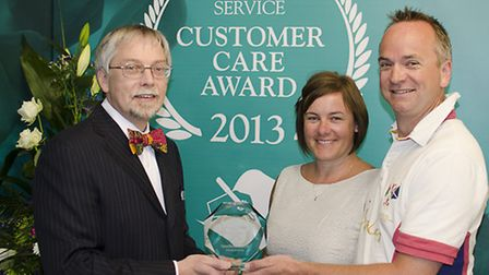 Matthew and Tracey Aldridge of F H Halliday & Son being presented with the Customer Care Award by Gr