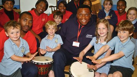 Members of the Zakhele dance group from South Africa with pupils.