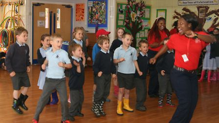 High Down pupils learning some moves from the Zakhele members