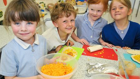 Pupils making sandwiches as part of their healthy eating project.