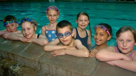 Children taking part in a sponsored swim to raise money for a pool roof.
