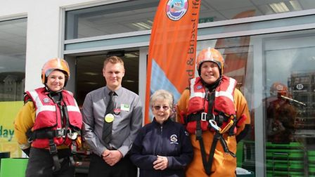 Lifeboat crew Sam Herbert and Jake Bacon, lifeboat trust vice patron Joan Herbert and store manager