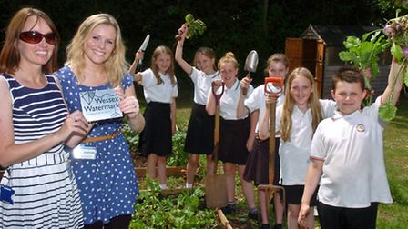 Gardening club pupils being presented with a watermark award.