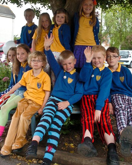 children wearing wacky trousers for wrong trousers day.