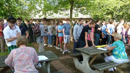 Backwell School students line up to get their results.