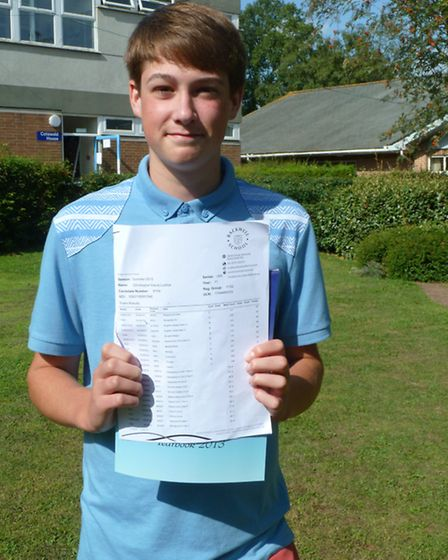 Chris Waldron opening his grades at Backwell School.