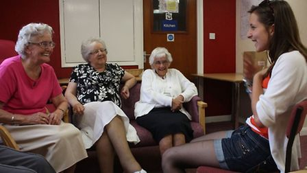 Pupils from Backwell School working with residents on a musical performance.