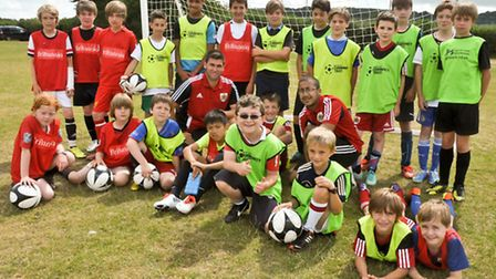 Bristol City Coaching team with young footballers.