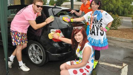 Andy, Amy Matt and Lucy from Homebase running a car wash.
