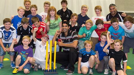 Gemaal Hussain (centre) with children from Winscombe Cricket Club