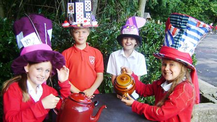 Lucy, Harri, Hannah, Amelia enjoying a mad hatter's tea party.
