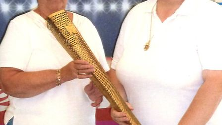 Lil Read (left) and Carol Hughes with the Olympic torch at Dartington Crystal, Devon last summer.