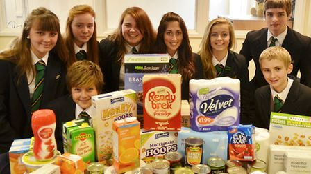 Clevedon School pupils with donations for the foodbank: Mackenzie Cob, Amelia Burgess, Maddie Wood,