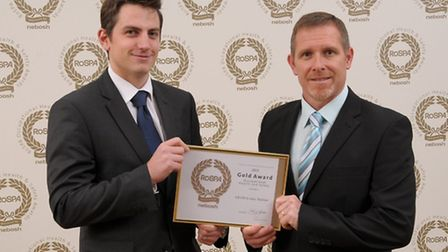 Peter Fuidge and Richard Payne from GE Oil and Gas with their gold award.