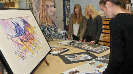 Visitors and Students looking at work by Nicole Matthews and Mia Eenthall.