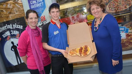 Paula Luke, Laura Bailey and Karl Smart with a bee pizza donated by Domino's
