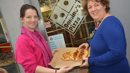 Paula Luke and Laura Bailey at BeeSocialSmart with a bee pizza donated by Domino's