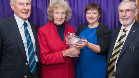 Harry Espiner and Jim Howard with Lady Gass presenting the award to Production Manager Michelle Keel
