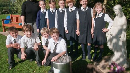 Head Teacher Sally Carter with pupils and the Time Capsule.