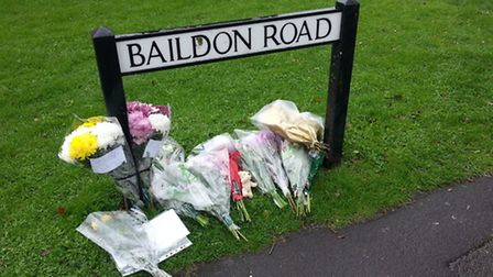 Flowers left in Baildon Road paying tribue to Mark Roberts