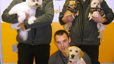 The team at A Dog's Day Out: Owners Andy Wilkinson (L) and Darren Tarpey (R) with member of staff Mi