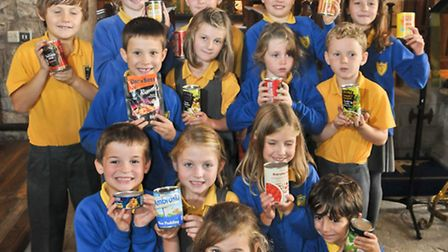 Children donating tinned food to Bristol homeless project.