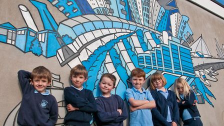 Preston, Max, George, Jacob, Abi and Seren with the newly painted mural.