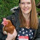 Leanne Preston with her chicken Windmill and her Royal Mail note.