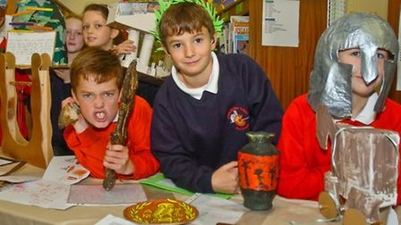 Children with thier items for a project on Greeks in they museum.