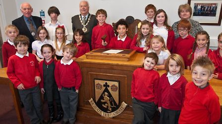 Pupils with Chairman Pat McNeill, Vice Chairman Nick Pennycott and Town Clerk Paula Heath.