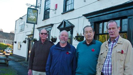 residents outside of the pub which has been listedas a community asset.