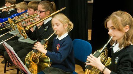 Nailsea School auditorium. Local schools joining to form an orchestra as part of gifted and talented