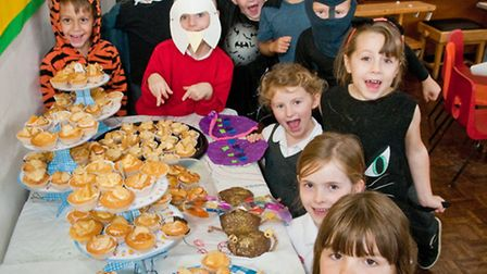 Staff and pupils in costume at their Wackey Wild Tea Party, dressed as animals or with model bugs th