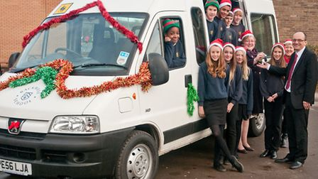 Chairman of Backwell School Association Karen Lee-Bapty handing over the keys of the minibus to Head
