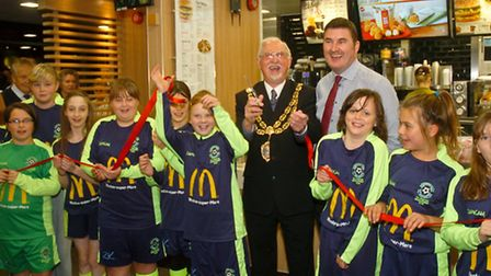 Mayor Cllr Keith Morris cuts the ribbon to open the refurbished Mc Donalds with owner Tim Lamb and t