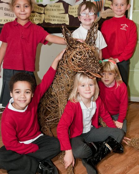 Pupils pictured with some of the sculptures they have helped make.