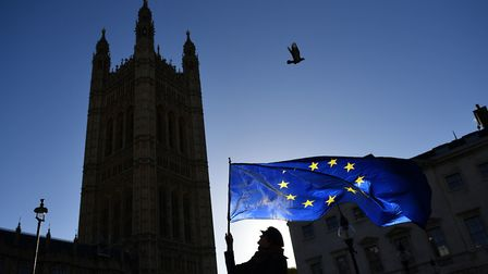 An anti-Brexit protestor waves an EU flag in Westminster. Photograph: Dominic Lipinski/PA Wire.