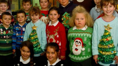 Children all dressed in thier Christmas jumpers.