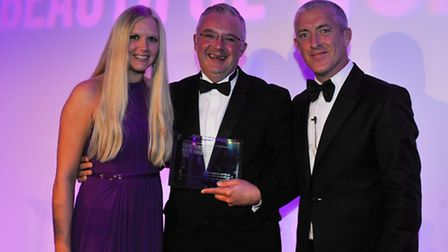 Joseph Rajkovic received an award from Rebecca Burgess, agency sales manager at Caribtours, and Paul