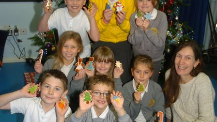 Children with pottery decorations they have made for the Christmas tree with Elaine Bruce