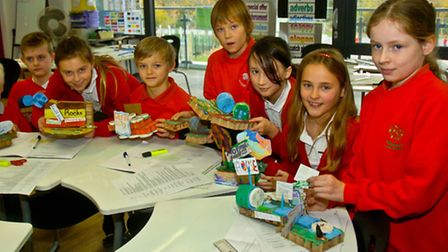 Children with seismograph they hae been using to record earthquakes around the world. with their mod