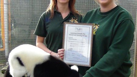 Noah's Ark Zoo Farm education officers Catherine Tisdall and Amy Lissemore with a black and white ru