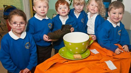 Foundation children who have found a giant's boot, clothes and tea cup.